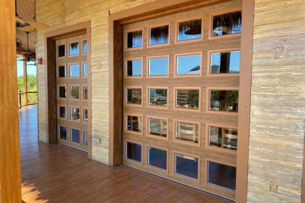 Insulated, fully glazed with Long Impact Rated Lexan Ultra Grain Cypress Medium Finish on Exterior Installed by D & D Garage Doors